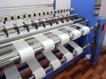 The manufacturing process of white filter mesh in small width.