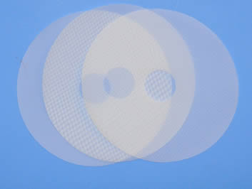 Three pieces of polyester disc filters with different mesh counts.