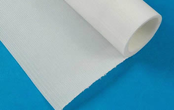 A roll of white polyester filter belt with heat-cut edge