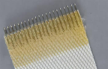 a piece of polyester filter belt with stainless steel clip seam sealed with yellow glue.